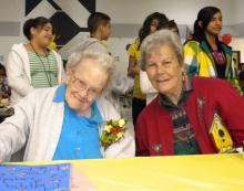 Bernadine Sitts (left) with her sister, celebrating her birthday with students at the Bernadine Sitts Intermediate Center